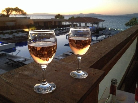 Villa Di Mare Luxury Suites : Pink fizz on our balcony with a pink sunset too - great apartment!!