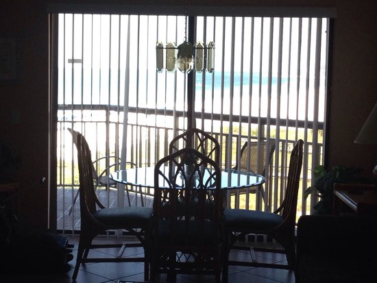 Gulf Strand Resort: Hard to see in this pic but we had an amazing ocean view from the dining room table .