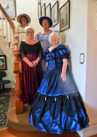 Peace and Plenty Inn: Some of my friends and myself posing on the beautiful staircase (I'm the one in the red dress).