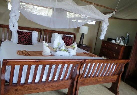 Linyanti Bush Camp- African Bush Camps: another view of the huge bed and mosquito net
