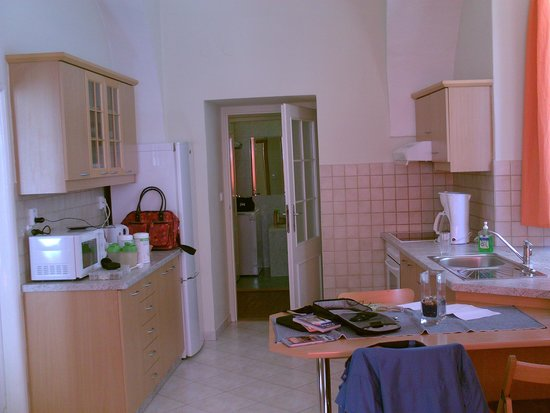 Happy Prague Apartments: view of kitchen and bathroom form the livingroom