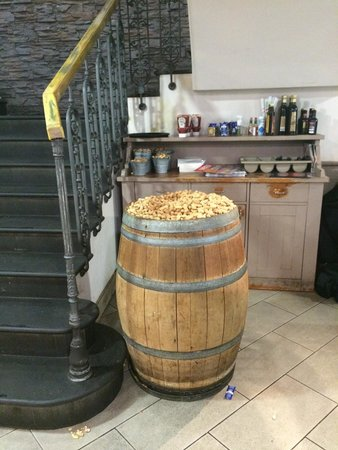 Roadhouse Grill : Cute barrels filled with complementary peanuts ��