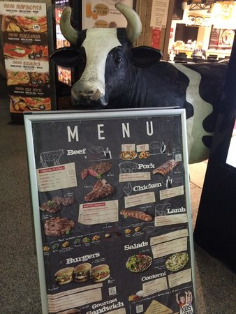 Roadhouse Grill : Mr. Cow outside the restaurant to greet u at the door ��