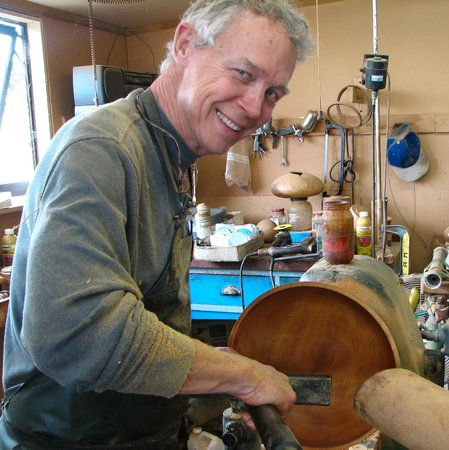 The Woodturners Kauri Gallery and Studio : student from the USA having a day wood turning tuition with Rick Taylor