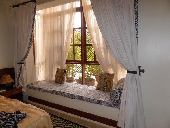 "The African Tulip: window seat in the ""zebra room"""