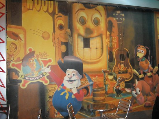 Toy Story wall art in Pizza Planet restaurant - Picture of Buzz ...