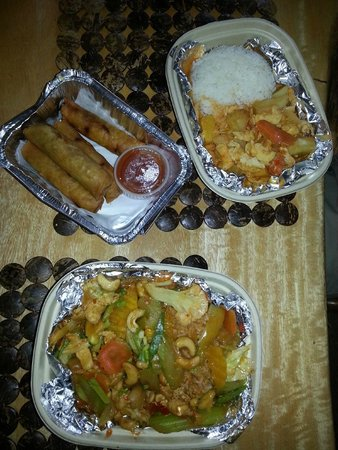 Tuk-Tuk Thai Food Truck: Clockwise from bottom: Cashew chicken, spring rolls, and chicken massaman curry.