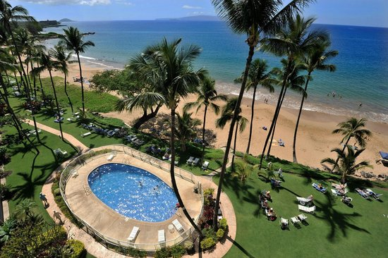 The Hale Pau Hana: Pool, lawn, beach and ocean at Hale Pau Hana Beach Resort