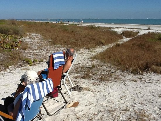 Sanibel Arms Condominiums: Got a bit windy on the beach, so we moved up a bit....stayed there for another 3 hours..