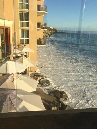 Surf & Sand Resort: We were told that a gigantic wave from the last storm actually reached these umbrellas