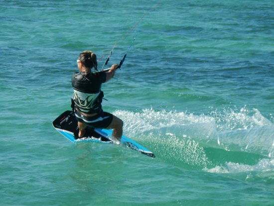 Sunset Cove: A kiteboarder enjoys her ride