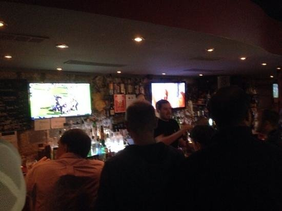 The Moose : Two of 4 big screens behind the bar.
