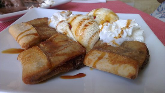 Il-Baxa Cafe Bar : Homemade 'mqaret'complemented with ice cream, fresh cream and drizzled with caramel sauce