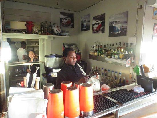 Slip Slops Kitchen Bar: pub area with barman