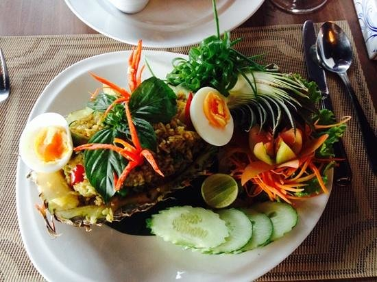Pan Bistro: Baked green curry fried rice with prawns served in a pineapple