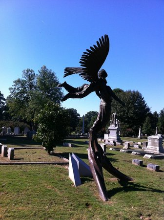 Elmwood Cemetery: Gorgeous bronze marker on the grave of a young man