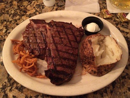 Black Angus Steakhouse: 24oz Porterhouse - delicious med rare best steak I've ever had
