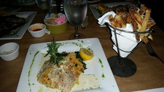 Fish Thyme: Horseradish Crusted Grouper served w/a side of Creamed Spinach & Parmesan Truffle Fries. DELICIO