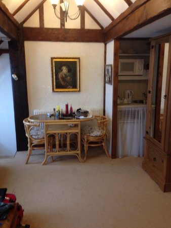 The Brufords Bed and Breakfast: Room 5 with table, small kitchenette and leather sofa which is out of the shot