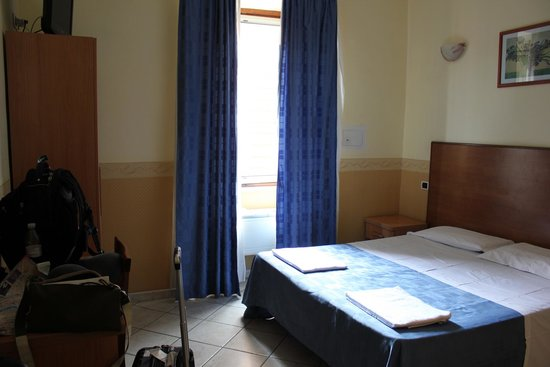 Independence Square : Double bed with ensuite washroom (note the extremely flat pillows)