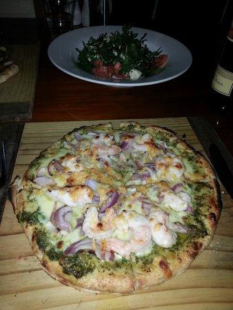 Pizza dish and salad