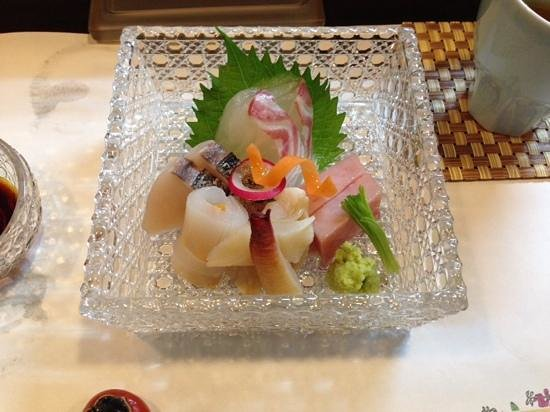 Sashimi of bream, spanish mackerel, uni wrapped in squid, tuna and mirugai clam