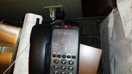 The Westin Convention Center Pittsburgh: Here is the phone and night stand