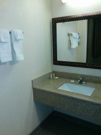 Days Inn Houston: Bathroom 1 of 3 showing sink and mirror