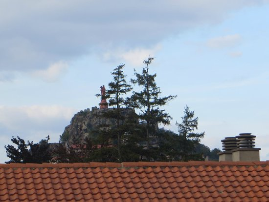 Chris'tel Hotel : Madonna statue above the rooftops
