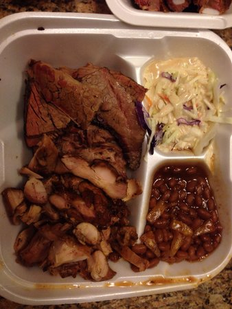 Coops Barbecue: We got it to-go. Brisket, jerk chicken, cole slaw, beans