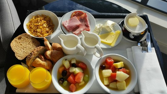Room service - breakfast (coffee/tea and toast on another tray ...