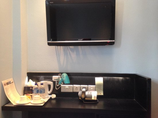 The Porcelain Hotel: TV and table
