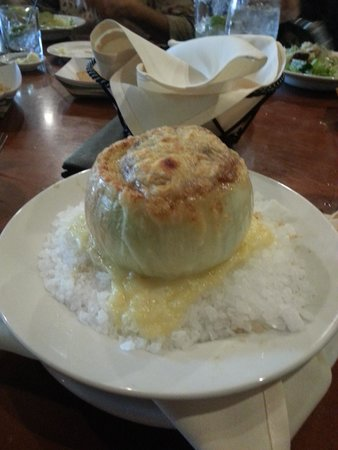 Tower Bridge Bistro - Embassy Suites Hotel Sacramento: French onion soup in onion bowl and held in place with rock salt. Great presentation