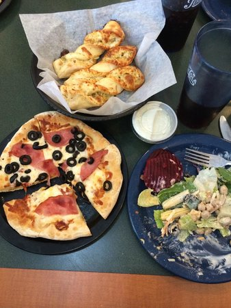 Round Table Pizza: pizza, twists, salad bar and unlimited refill drinks less than 12$ per person