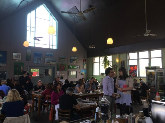 Fig Tree Cafe Upper Hutt: Dated interior with amateur art displayed