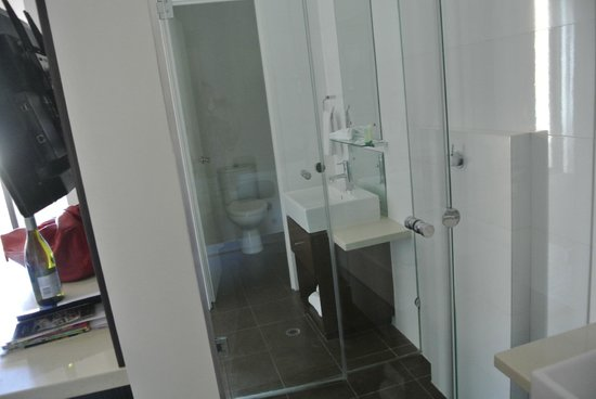 Ramada Perth, The Outram: Looking from the vanity on the right, through the shower, to the toilet beyond