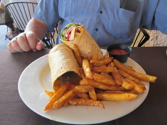 Shelby's Bistro: Tequila lime Chicken Wrap with a side of fries, enjoyed by my friend John