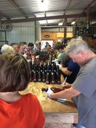 Garrison Brothers Distillery: Dan Garrison personally numbering each bottle that comes across