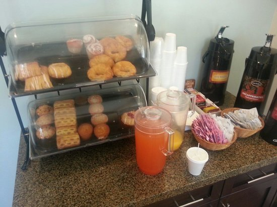 """PB Surf Beachside Inn: """"Free Breakfast 7am-10am"""" Stale pastries and warm juices."""