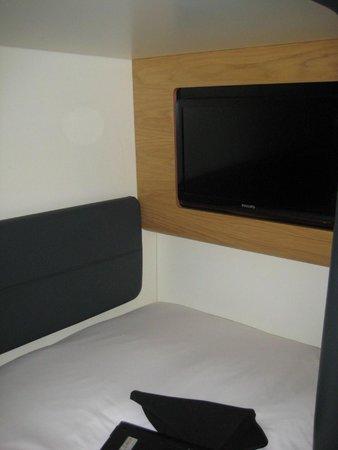 YOTELAIR London Heathrow Airport: TV at foot of bed.