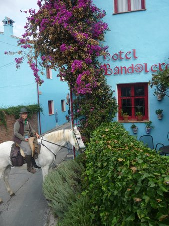 Ride Andalucia: Karen leading the way through Juzcar, the Smuft village painted blue!