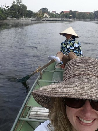 Hanoi Urban Adventures: Boat Ride - yes she is paddling with her feet!