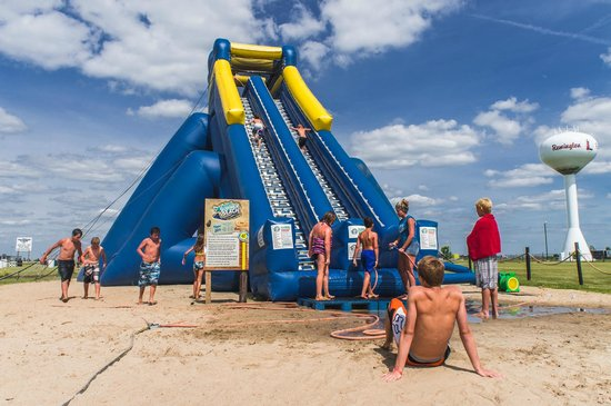 Caboose Lake Campground: 35' Inflatable water slide is a enjoyed by adults and teens.