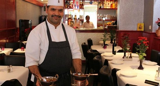 Our Chef making tandoori chicken. - Picture of Kathmandu Kitchen ...