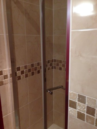 Room 14 power shower cubicle with hair and body wash and ...