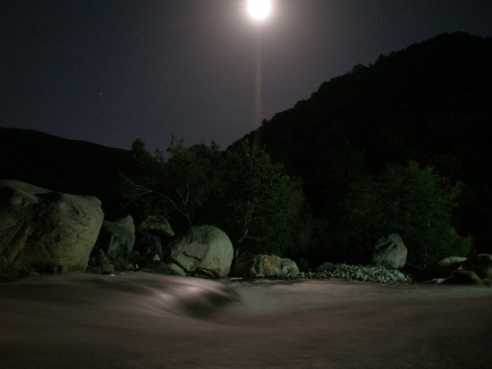 Buckeye Tree Lodge: The river flowing through the backyard of the Lodge under a full moon