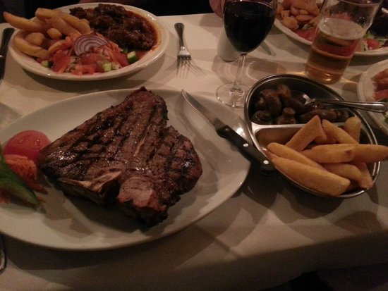 Bella Pais: 22oz charcoal grilled t-bone steak, chips and mushrooms. Awesome!