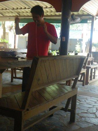 Fixing fishinggear at Hippo Cafe Koh Chang