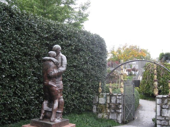 River Gallery: Sculpture of Father greeting Soldier Son home