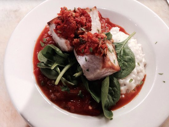 Sips: Swordfish with tomato Mediterranean stew